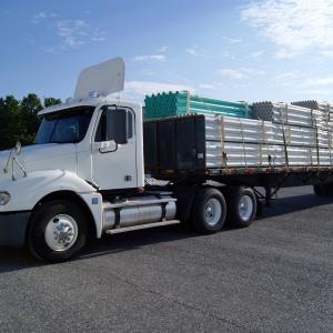 What are the logistics that brokers consider when they choose truck transportation?